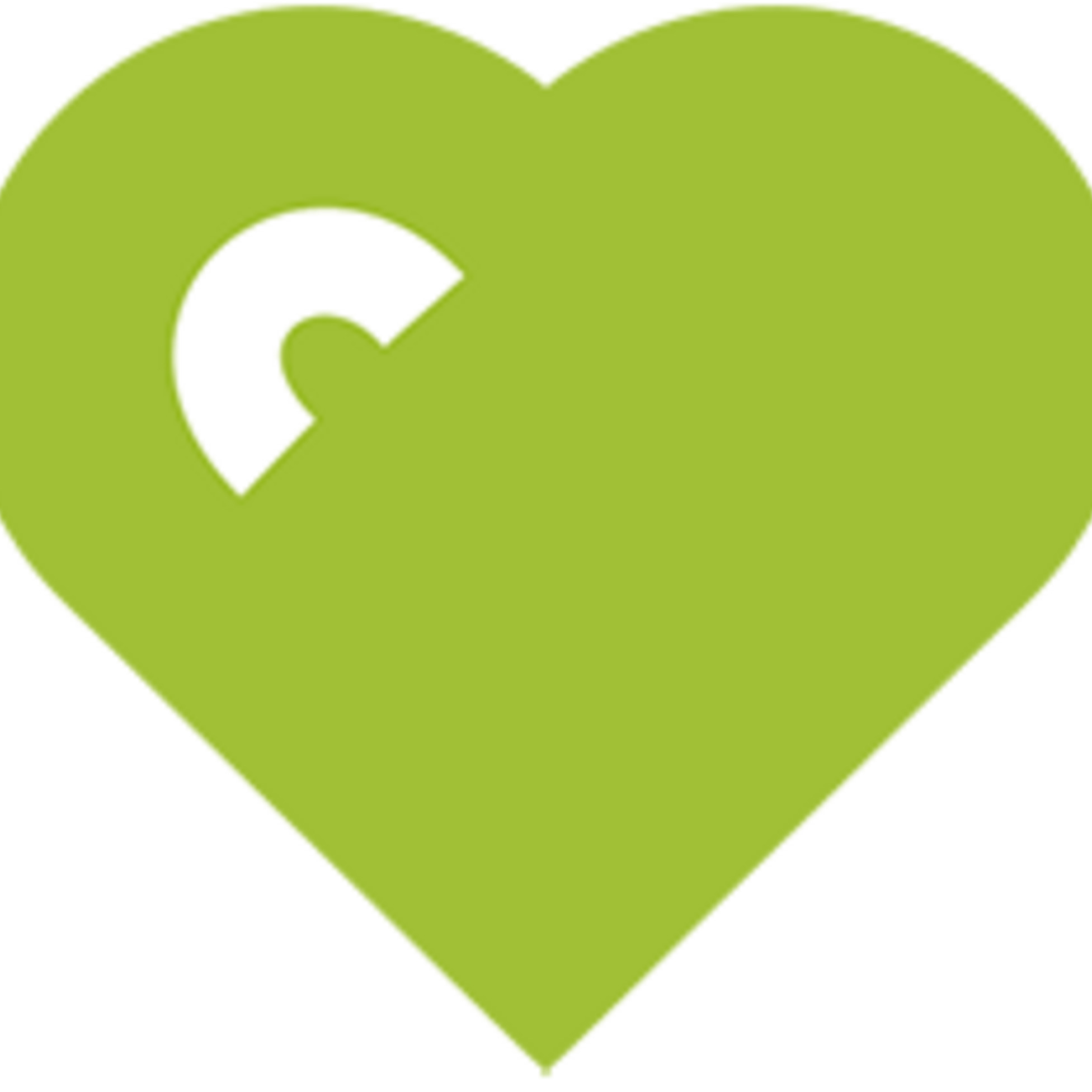 Grünes Herz vor grauem Hintergrund